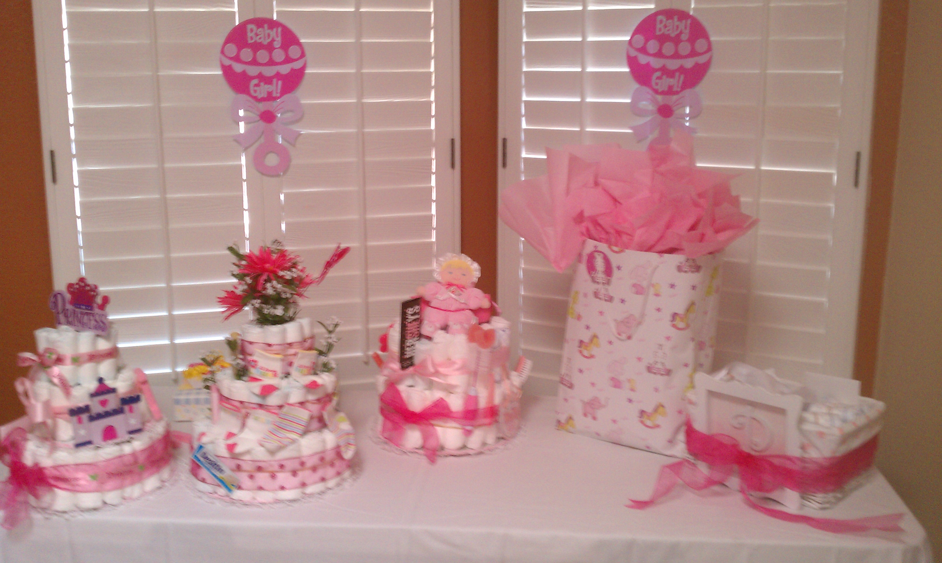 tables chairs pink linens and a baby shower it s a girl